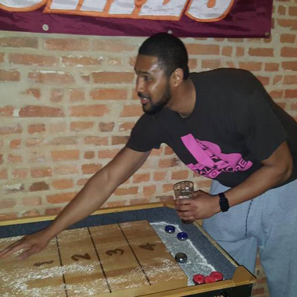 Shuffleboard sand fun adult shuffle board social bar drinking cheers